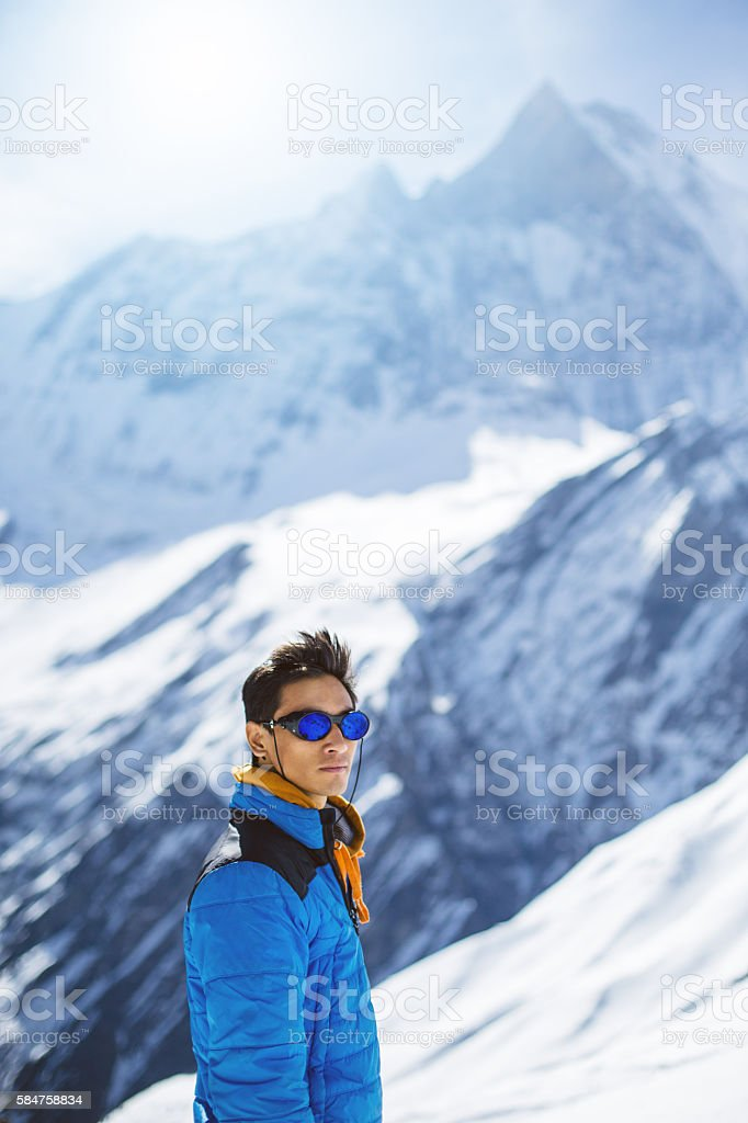 Sherpa mountaineer in Himalayas stock photo
