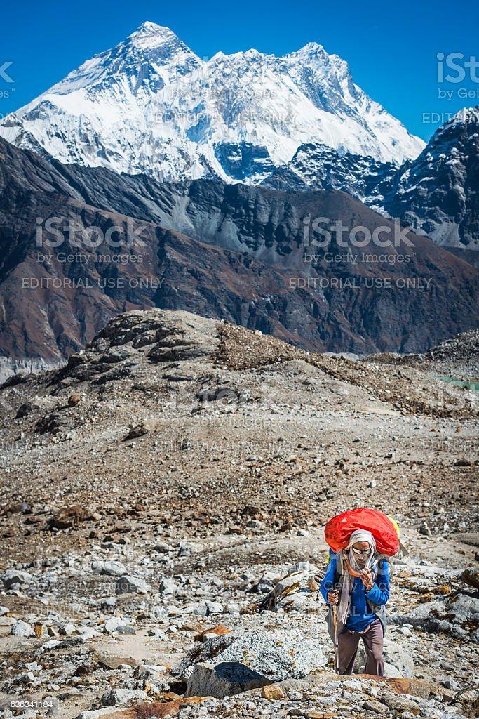 Sherpa porter mountaineer climbing below Mt Everest peak Himalayas Nepal stock photo