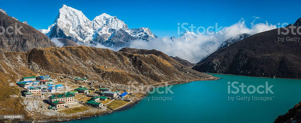 Sherpa village teahouses Gokyo overlooked by Himalayan mountain peaks Nepal stock photo