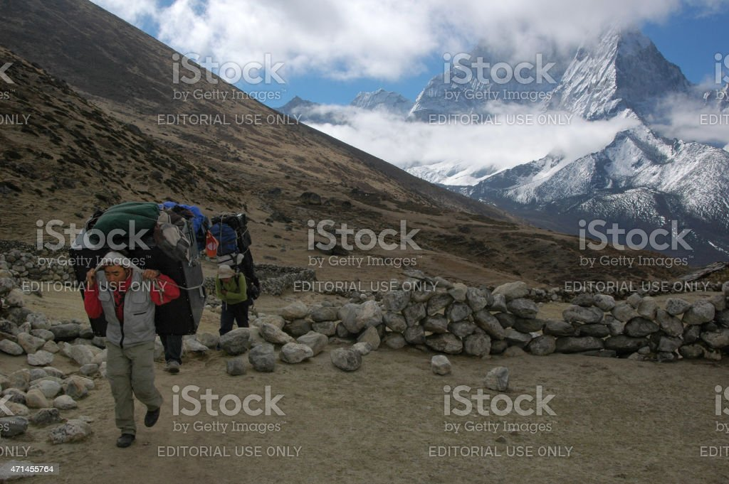 Sherpas on the way to the Everest base camp stock photo