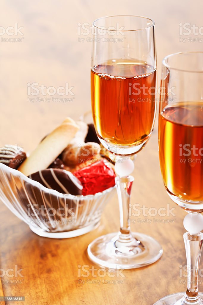 Sherry glasses and pralines in a bowl stock photo