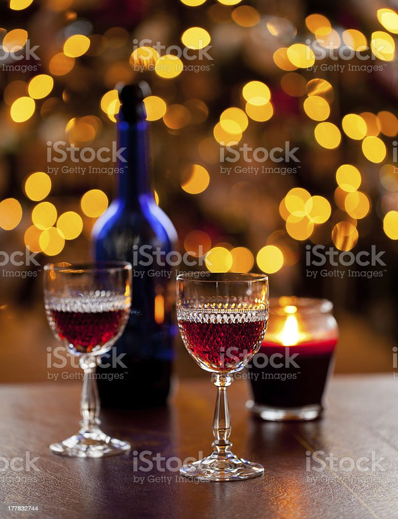 Sherry glasses in front of xmas tree stock photo