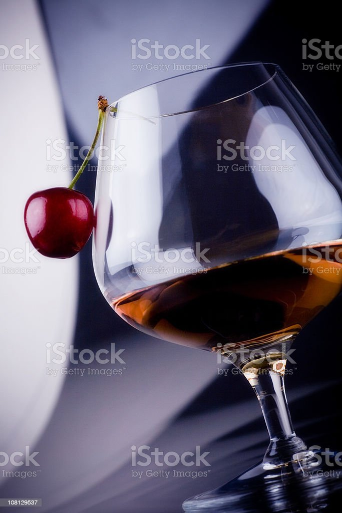 Sherry in Glass with Cherry stock photo