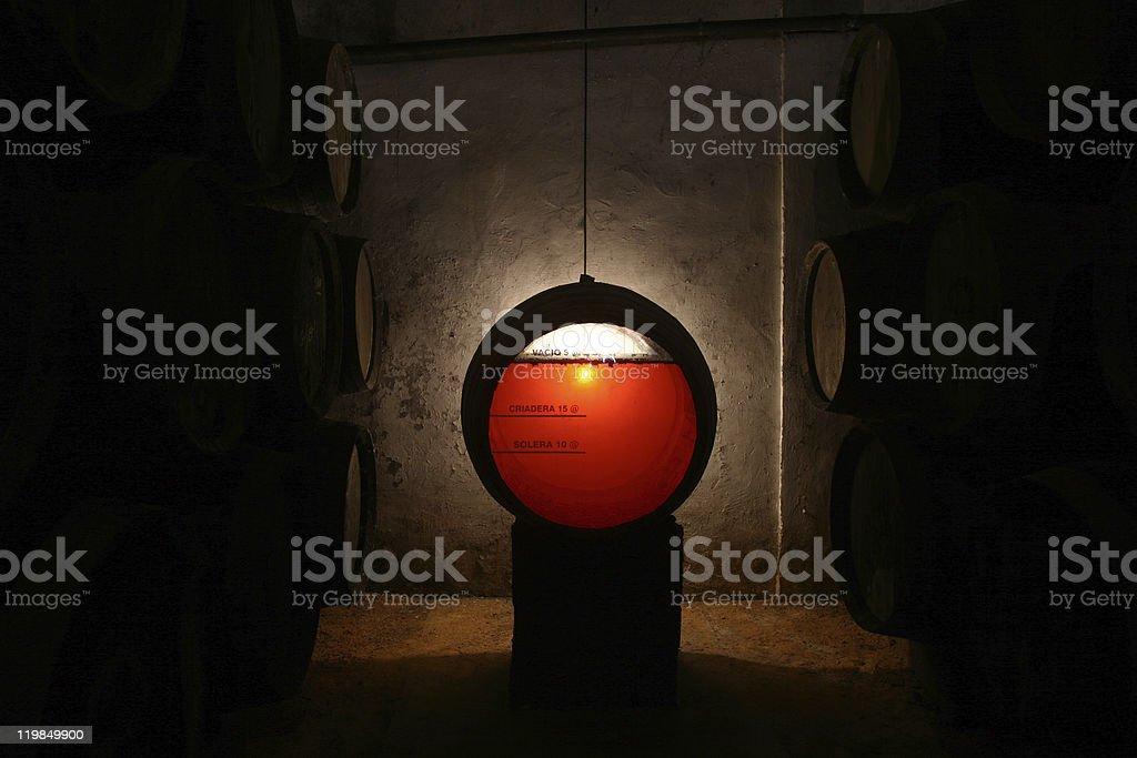 sherry wine barrel in old cellar stock photo