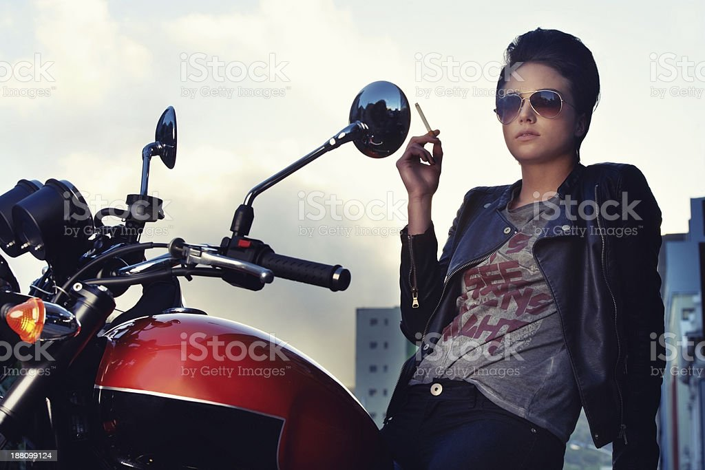 She's a hardcore biker chick stock photo