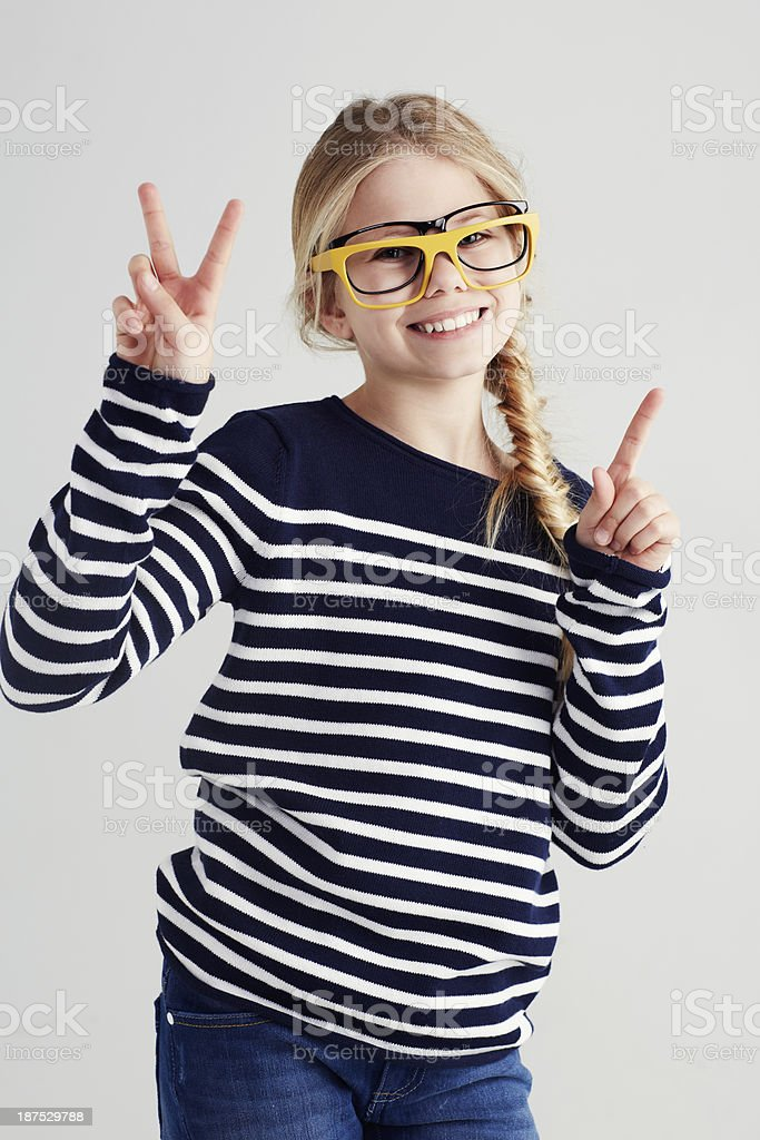 She's a playful hipster in the making! stock photo