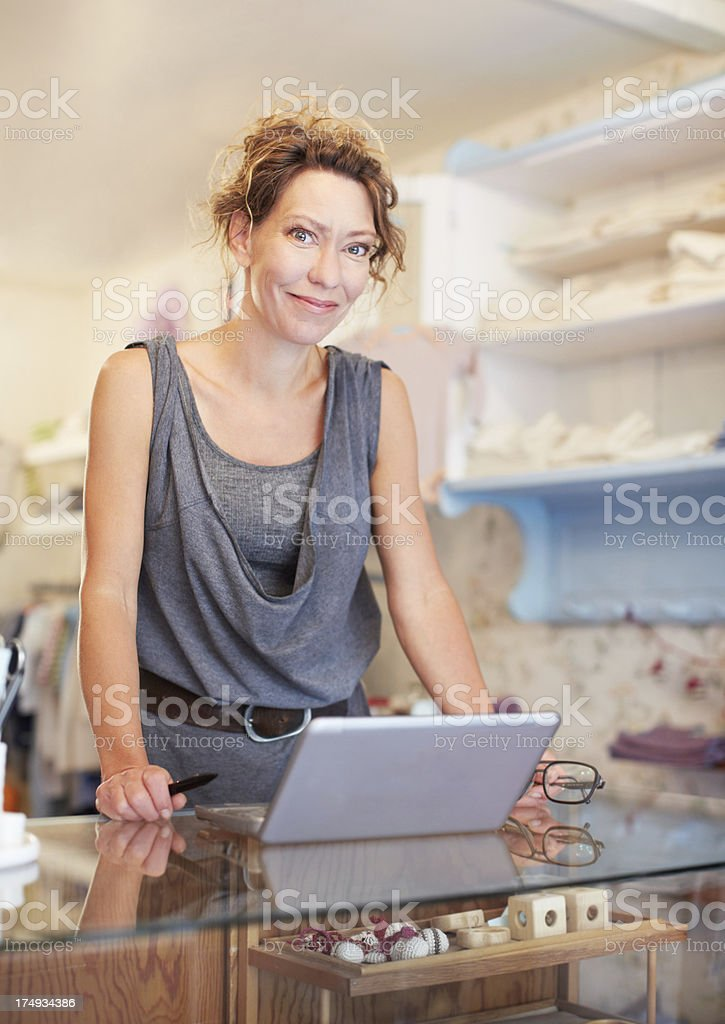 She's a savvy store owner royalty-free stock photo