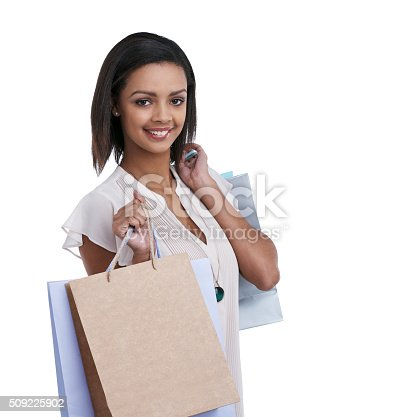 Studio portrait of a young woman carrying shopping bags against a white backgroundhttp://195.154.178.81/DATA/i_collage/pu/shoots/806341.jpg