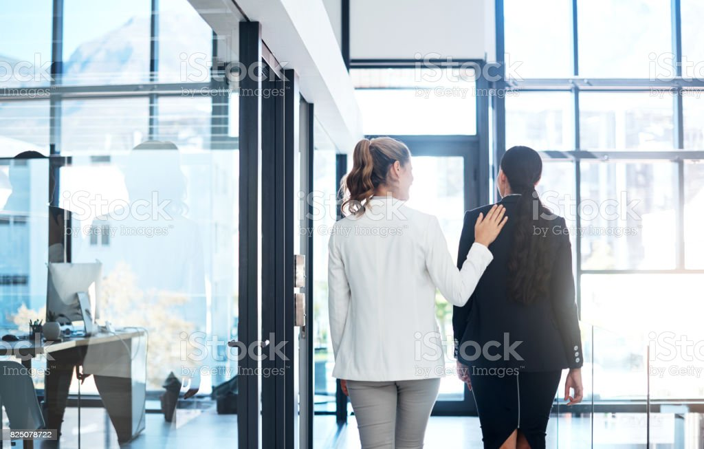She's a warm and welcoming coworker stock photo