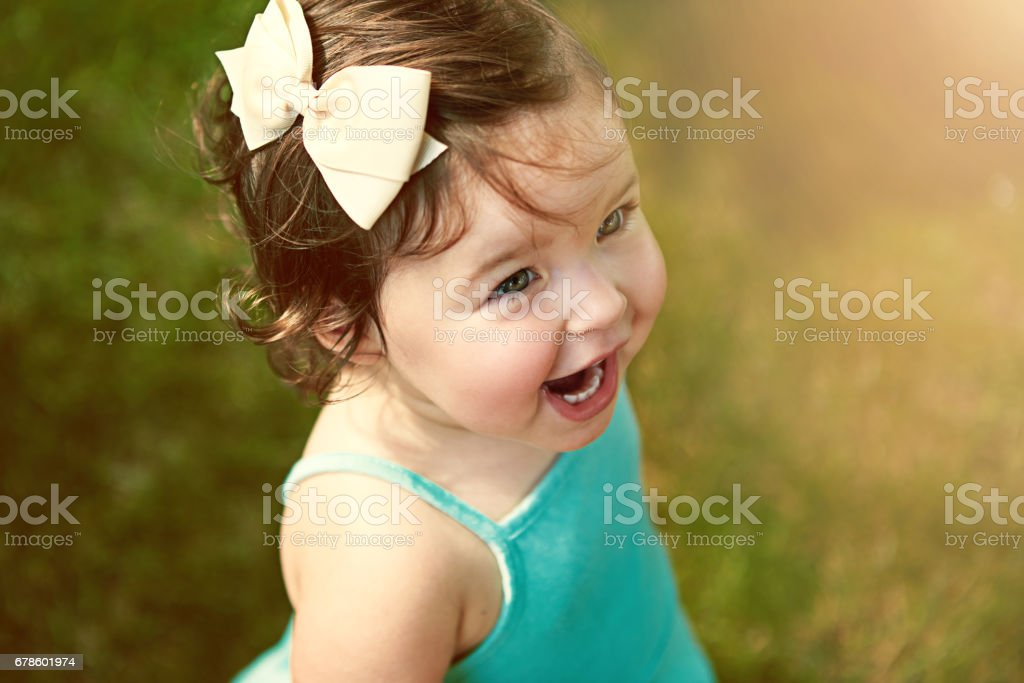 She's adorable as can be stock photo