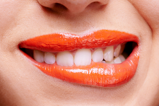 She's anything but ordinary in orange stock photo