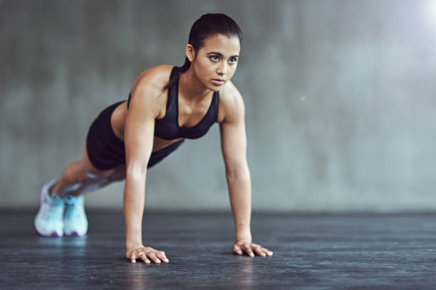 she's at the gym 24/7 - push up stock photos and pictures