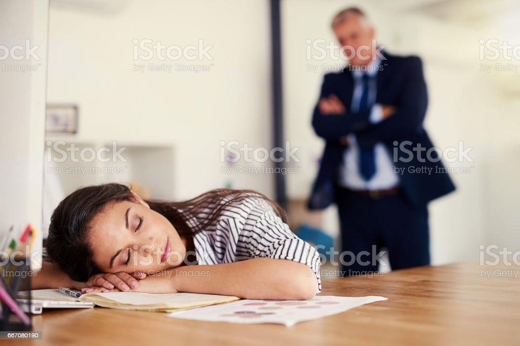 She's been caught sleeping on the job stock photo