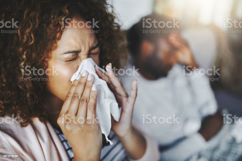 She's been sneezing non-stop stock photo