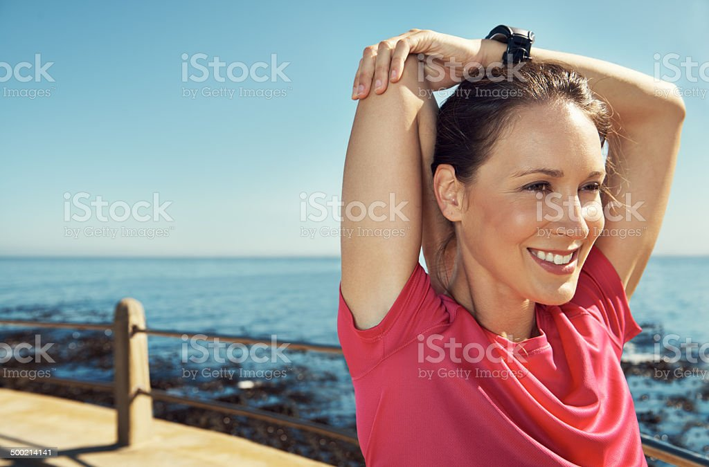 She's excited for her jog beside the sea stock photo