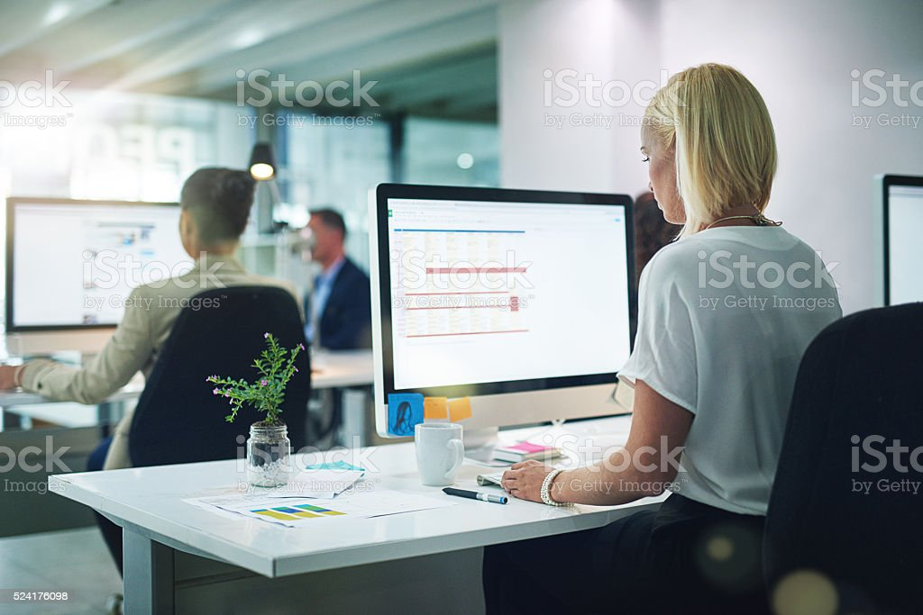 She's focused on the task at hand stock photo