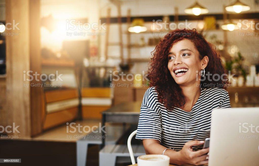 She's found the cafe with the fastest wifi zbiór zdjęć royalty-free