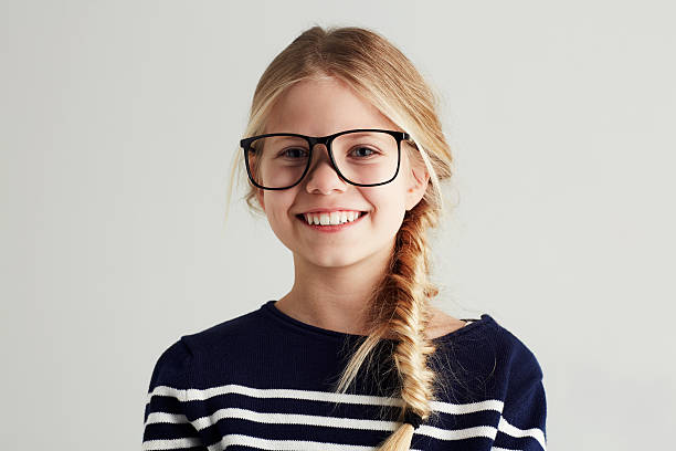 She's got a bright future ahead! Portrait of a cute girl giving you a toothy smile while wearing hipster glasses 12 13 years stock pictures, royalty-free photos & images