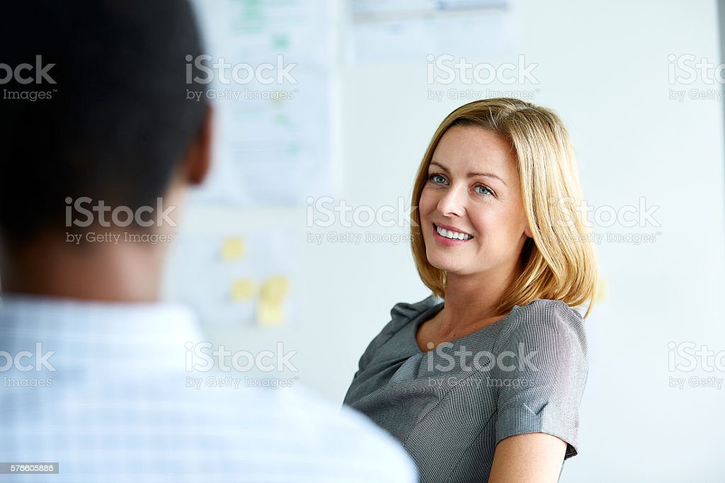 She's got a good feeling about this meeting stock photo