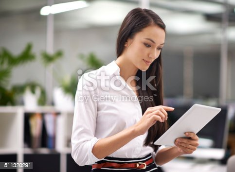 Cropped shot of an attractive young woman using a digital tablet in the office