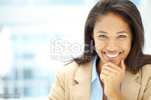 A gorgeous businesswoman smiling at you confidently - Copyspace