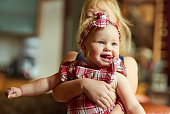 Shot of an adorable baby girl playing with her older sister at home