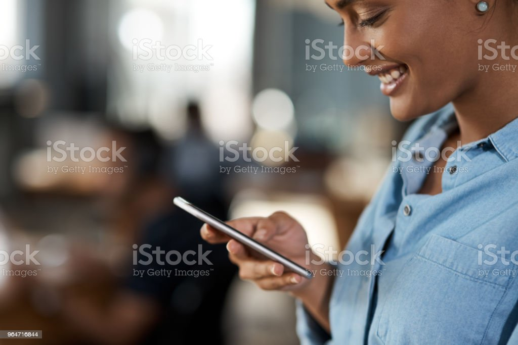 She's got her workday all planned on her phone royalty-free stock photo