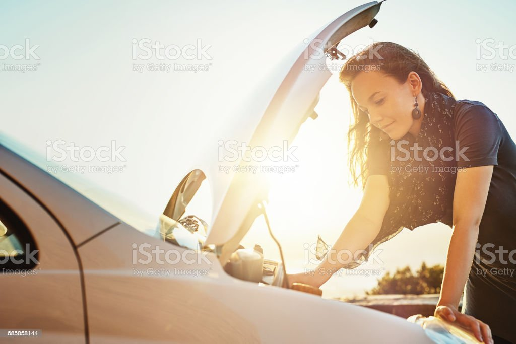 She's got some mechanical difficulties with her car stock photo