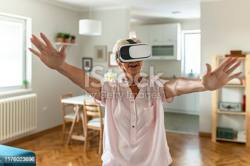 1053414472 istock photo She's got virtual reality in her hands 1176023696