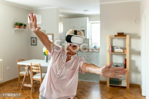 1053414472 istock photo She's got virtual reality in her hands 1176023717