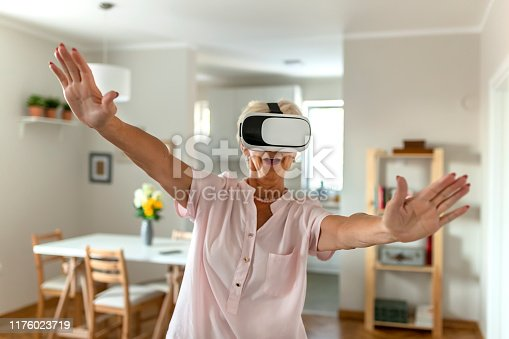 1053414472 istock photo She's got virtual reality in her hands 1176023719