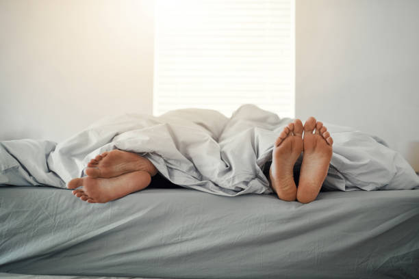 She's had enough Full length shot of an unrecognizable young woman lying with her back towards her husband after an argument in their bed at home couple in bed stock pictures, royalty-free photos & images