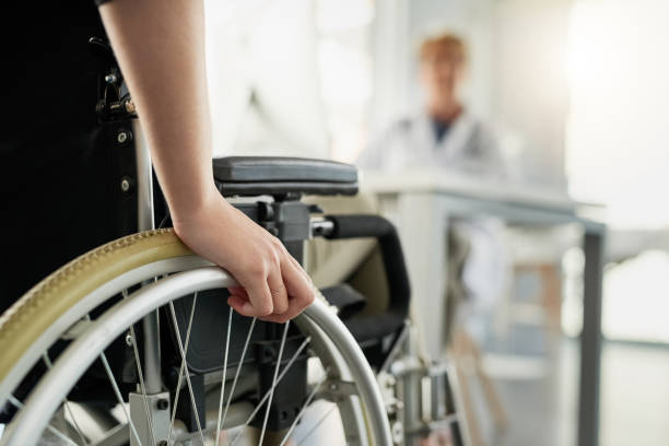 She's here for a second opinion Cropped shot of an unrecognizable woman in a wheelchair visiting the doctor's rooms for a consultation paraplegic stock pictures, royalty-free photos & images