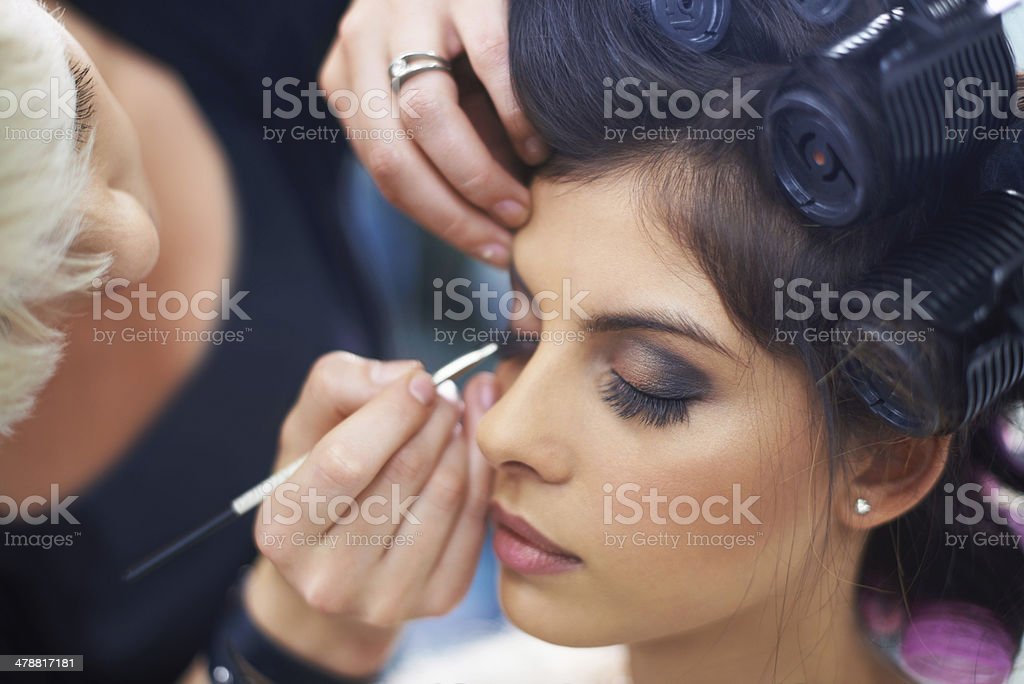 She's meticulous with her make up stock photo
