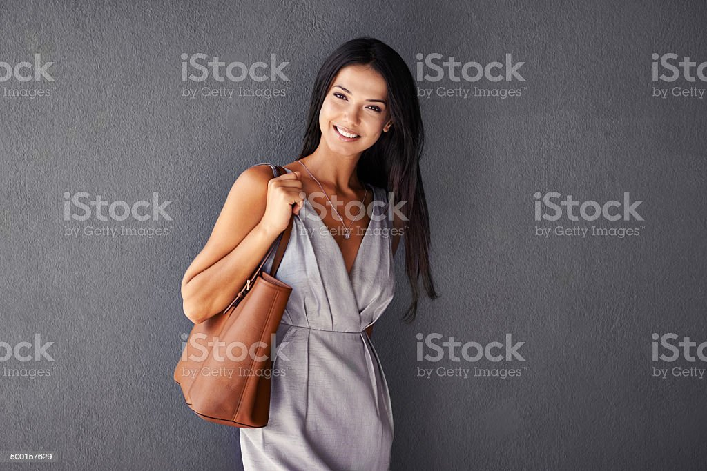 She's packing a purse and a smile stock photo