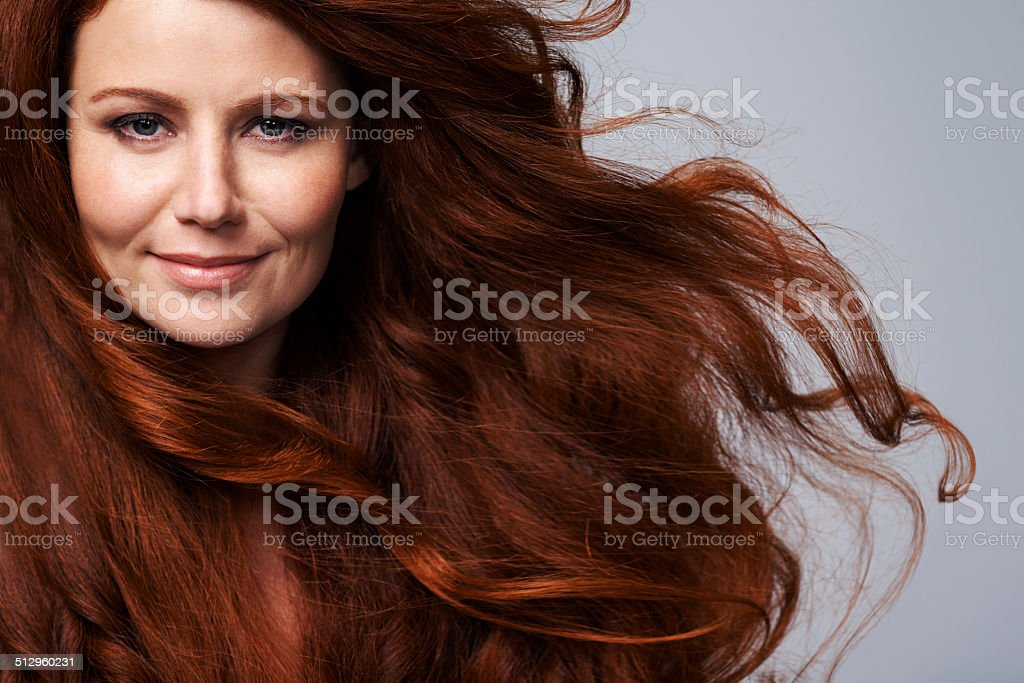 She's radiant in red stock photo