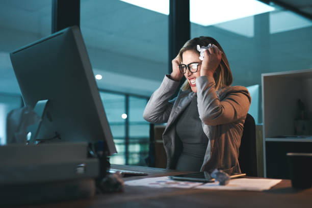 She's reached her breaking point Shot of a young businesswoman looking frustrated while working late in an office agitation stock pictures, royalty-free photos & images