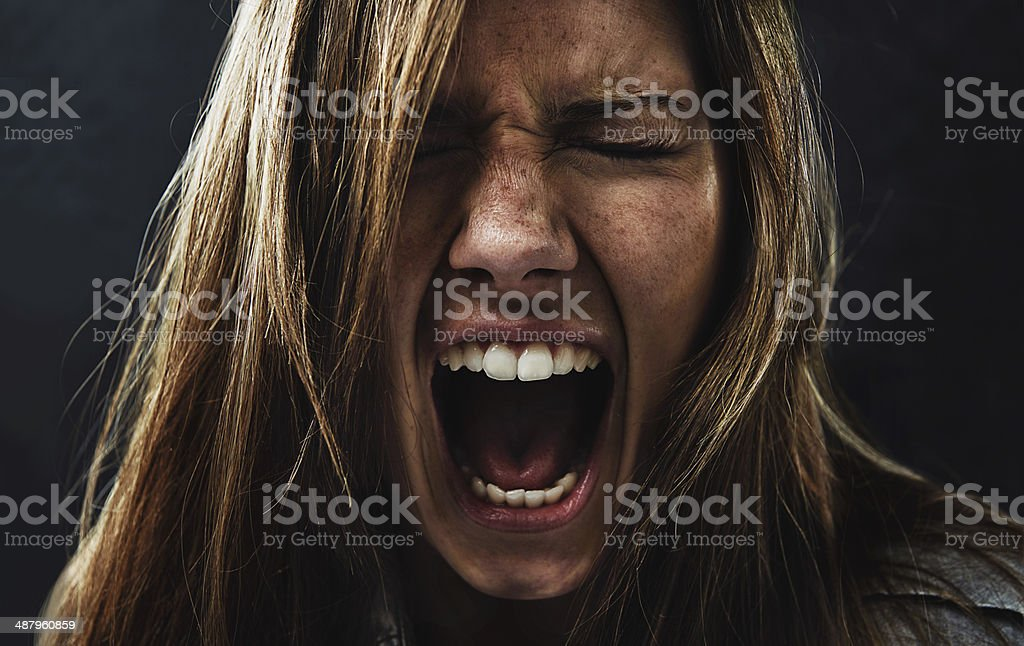 She's reached the end of her rope! A young woman screaming uncontrollably while isolated on a black background Adult Stock Photo
