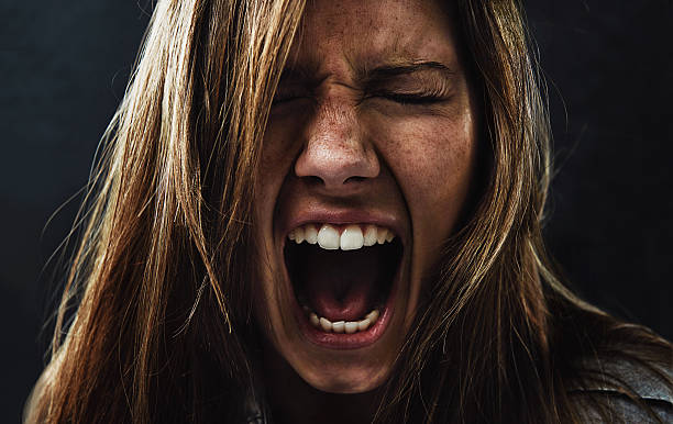She's reached the end of her rope! A young woman screaming uncontrollably while isolated on a black background crying stock pictures, royalty-free photos & images