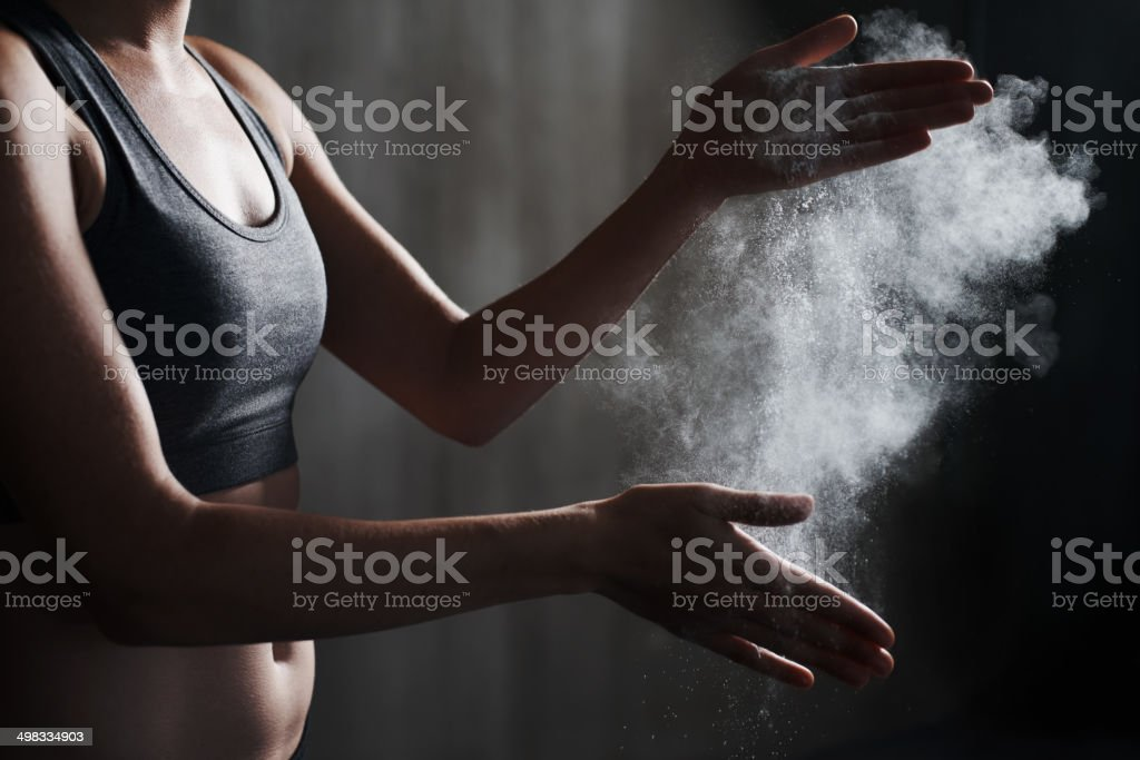 She's ready to give it her all! A cropped view of a female sportswoman dusting her hands with chalkhttp://195.154.178.81/DATA/i_collage/pi/shoots/783431.jpg Active Lifestyle Stock Photo