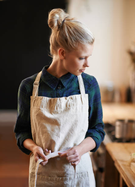 she's ready to make another batch of coffee - apron stock pictures, royalty-free photos & images