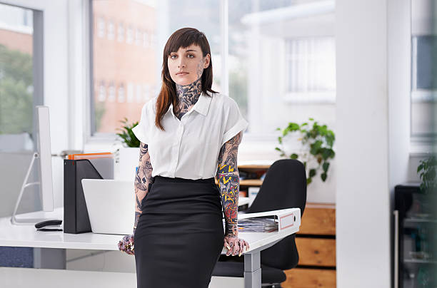she's ready to rock the corporate scene - tattoo stock photos and pictures