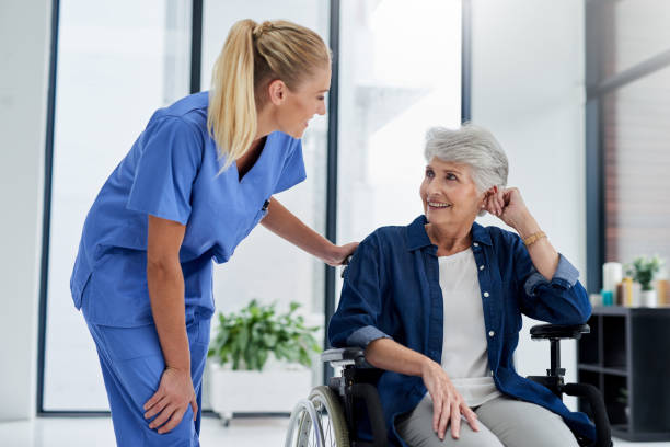 She's skilled at meeting the needs of her patients stock photo
