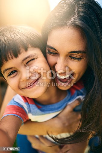 Closeup portrait of an attractive young woman and her young son outside