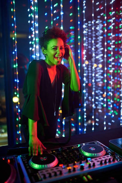 She's the headline act Portrait of an attractive young female dj playing in a nightclub electronic music stock pictures, royalty-free photos & images