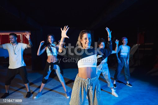 Group of young caucasian dancers practicing their dancing act at the dance studio