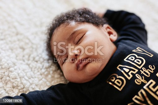 High angle shot of an adorable little baby girl sleeping peacefully at home