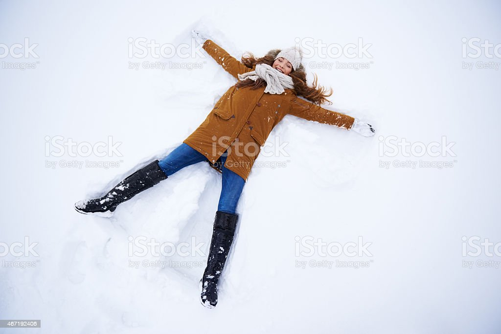 She's the perfect snow angel stock photo