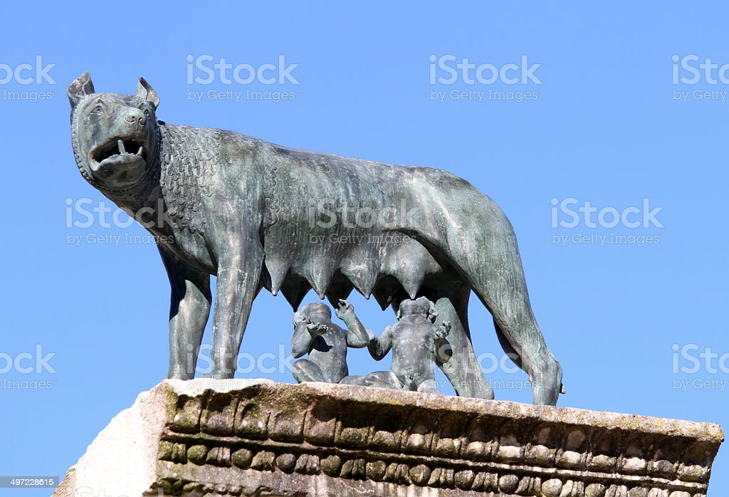 she-wolf nursing twins while founders of Rome stock photo