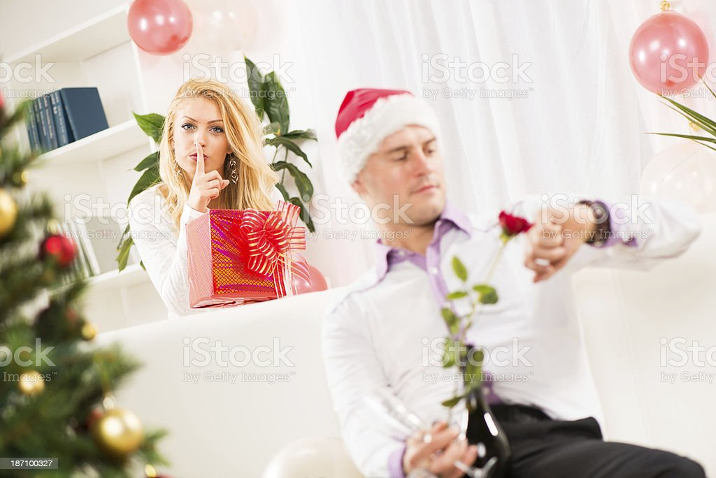 Shhhh, I have a Christmas gift for him royalty-free stock photo